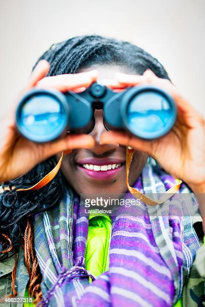 Curious African woman with binoculars