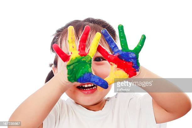 Curious child Looking from colorful hands