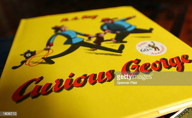 A 'Curious George' book sits on a table August 1 2001 in New York City Ron Howard Universal and Brian Grazer''s production company Imagine...