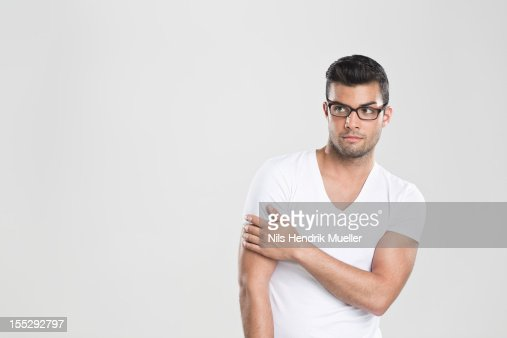 Curious man holding arm