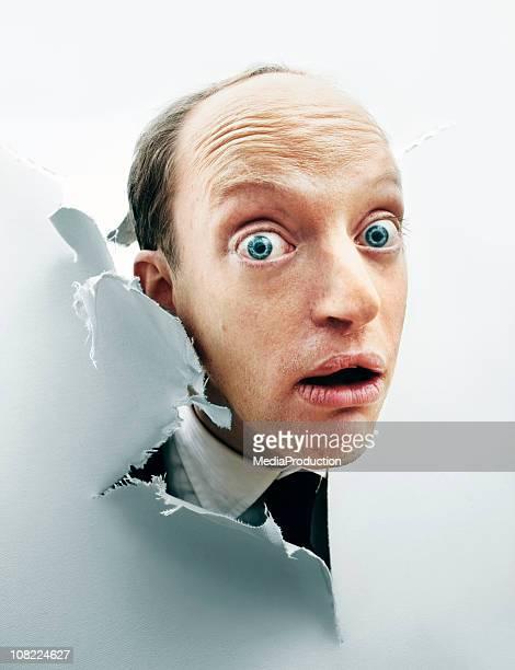 Curious Man Poking Head Through Broken Canvas