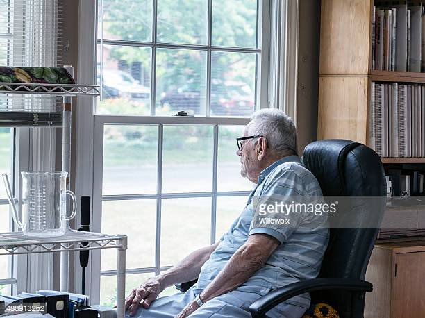 Curious Senior Man Looking Through Window