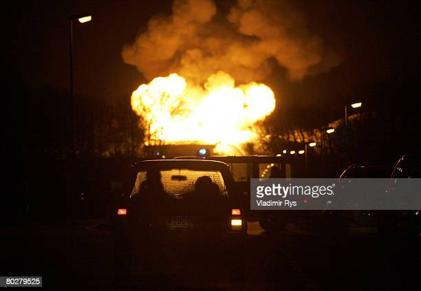 Curious spectators follow from their car the raising flames after a tank explosion at the Ineos factory on March 17 2008 at Worringen near Cologne...