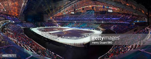 Curler Ayumi Ogasawara of the Japan Olympic team carries her country's flag during the Opening Ceremony of the Sochi 2014 Winter Olympics at Fisht...