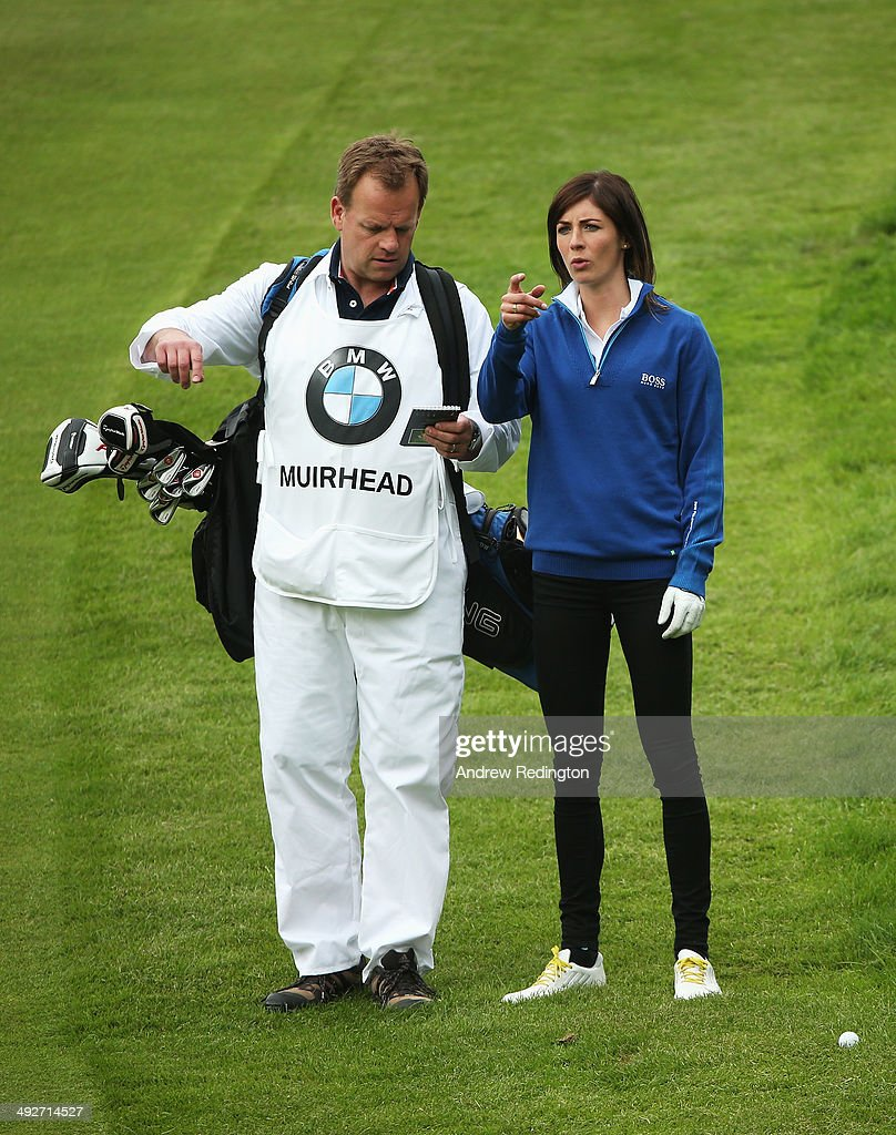 Curler Eve Muirhead talks to her caddie during the ProAm ahead of the BMW PGA Championship at Wentworth on May 21 2014 in Virginia Water England