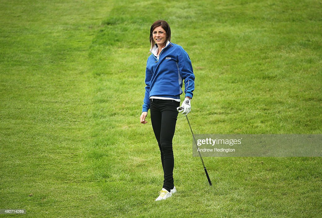 Curler Eve Muirhead watches her approach shot during the ProAm ahead of the BMW PGA Championship at Wentworth on May 21 2014 in Virginia Water England