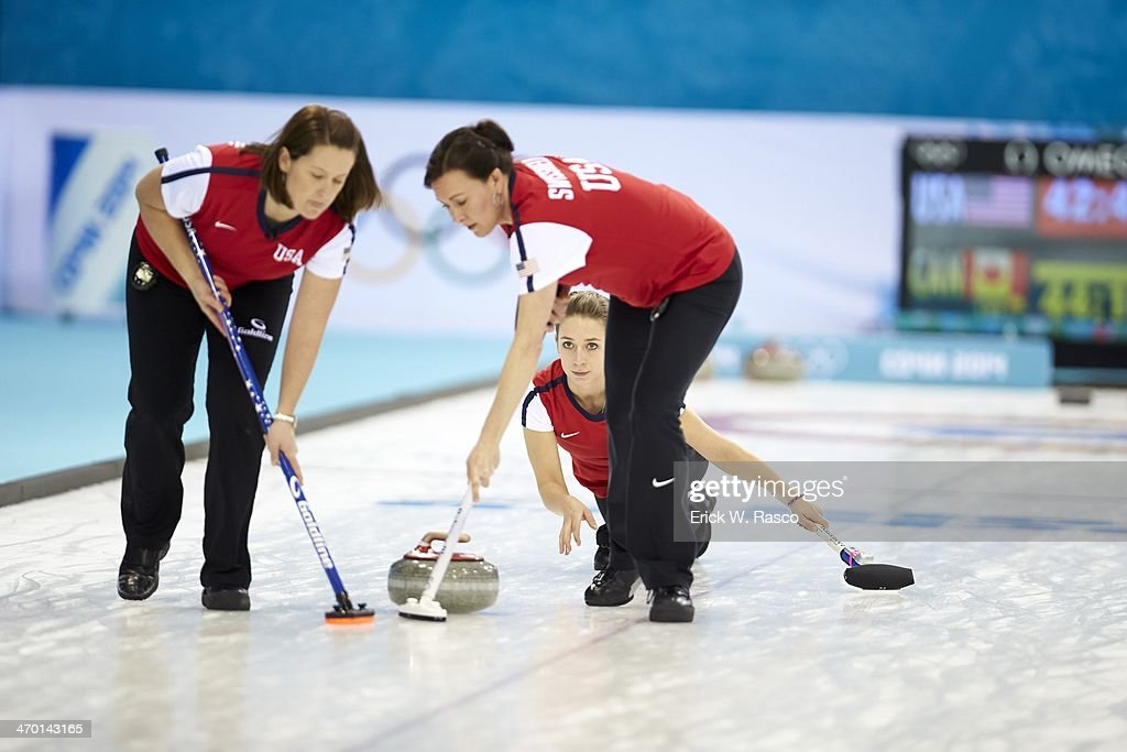 2014 Winter Olympics USA Jessica Schultz Debbie McCormick and Ann Swisshelm in action vs Canada during Women's Round Robin Session 10 at Ice Cube...