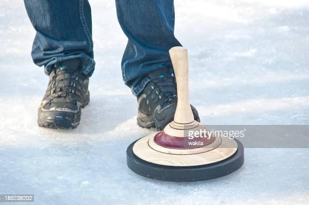 curling-stock-sport-Eisstockschießen mit Schuh