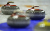 Curling rocks are seen during the Olympic Qualification Tournament match between Japan and France on December 11 2013 in Fussen Germany