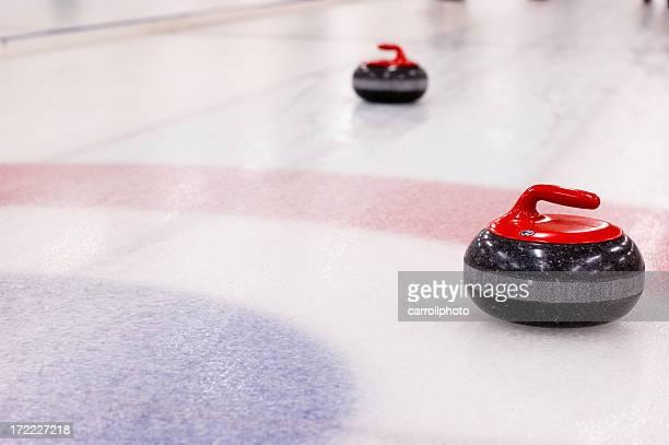 Curling Rocks auf dem Eis