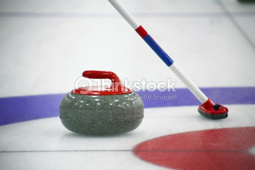 Curling Stone And Broom On The Ice Stock Photo Thinkstock