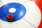 Curling stone on ice rink