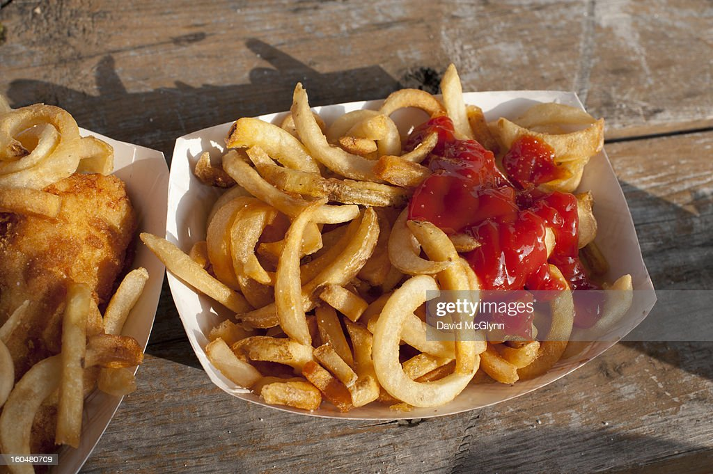 Curly French fries with ketchup : Stock Photo