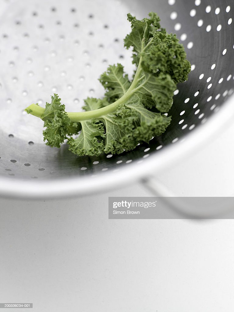 Curly kale leaf in colander, close up, elevated view : Stock Photo