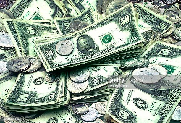 U.S currency, dollars, bills and coins.