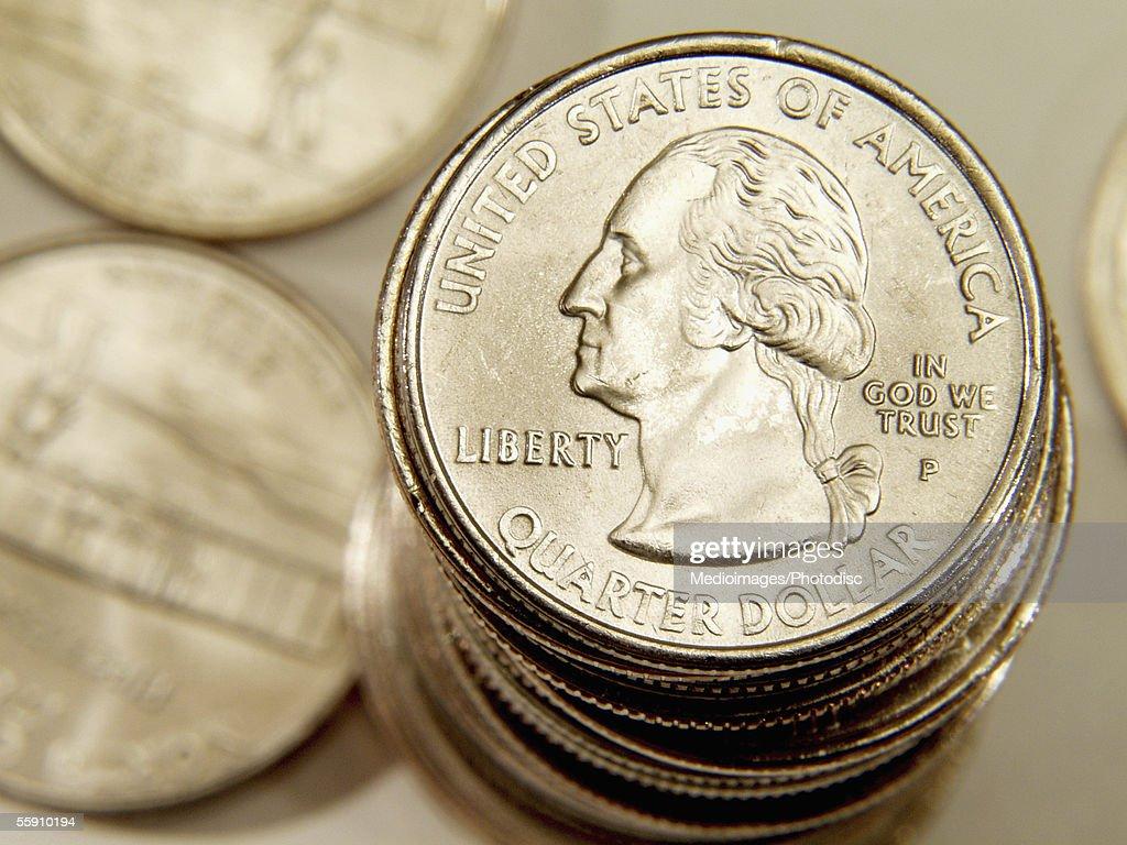 U.S. currency : stack of quarter dollars
