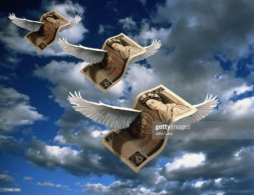 UK currency, ten pound notes with wings in sky (Digital Composite)