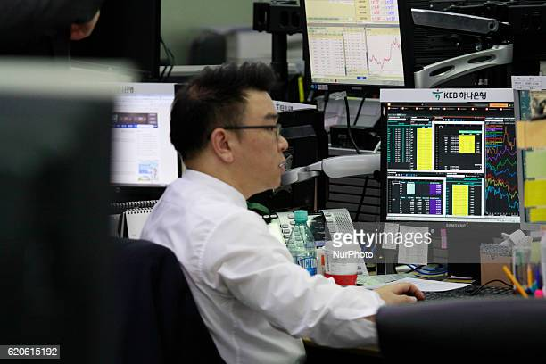 A Currency trader work at the foreign exchange dealing room of the KEB Hana Bank head quarters in Seoul South Korea on 2 November 2016 Japans Nikkei...