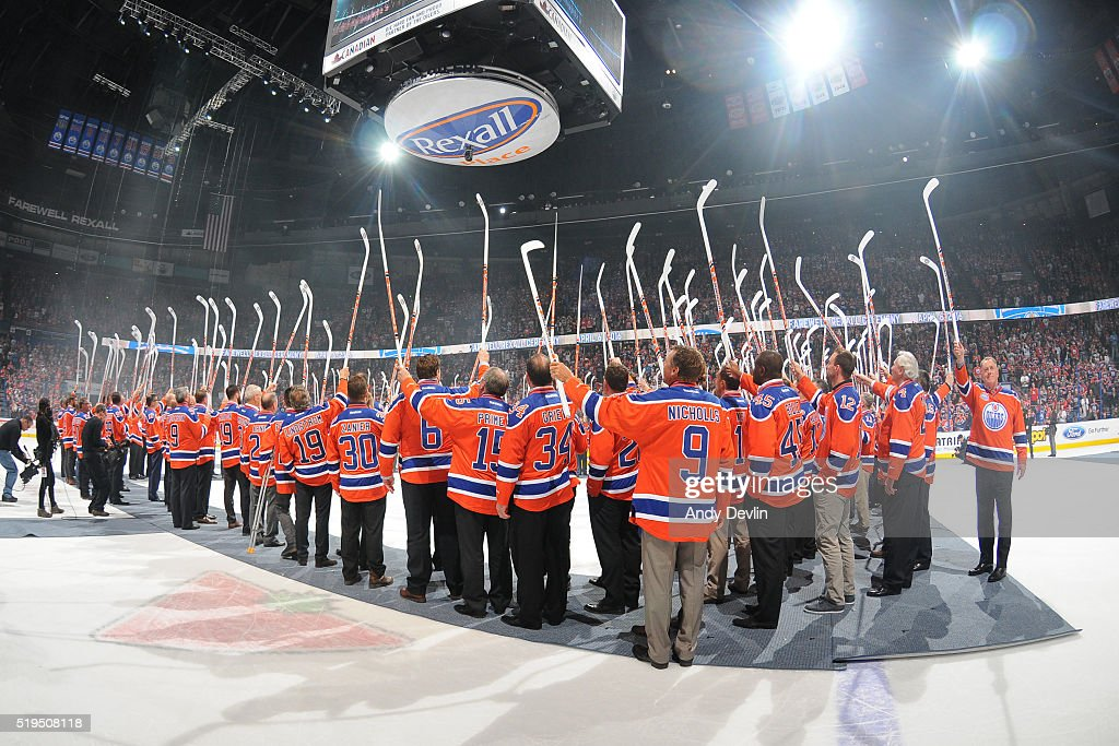 Current and former players of the Edmonton Oilers salute the crowed during the Farewell to Rexall Place ceremony following the game against the Vancouver Canucks on April 6, 2016 at Rexall Place in Edmonton, Alberta, Canada.