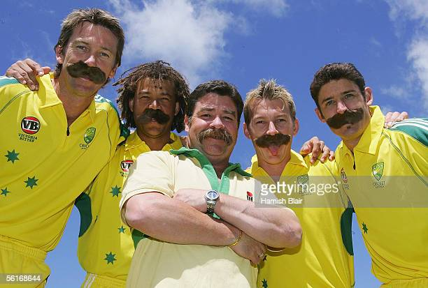 Current Australian players Glenn McGrath Andrew Symonds Brett Lee and Mike Hussey pose with former Australian cricketer David Boon wearing imitation...