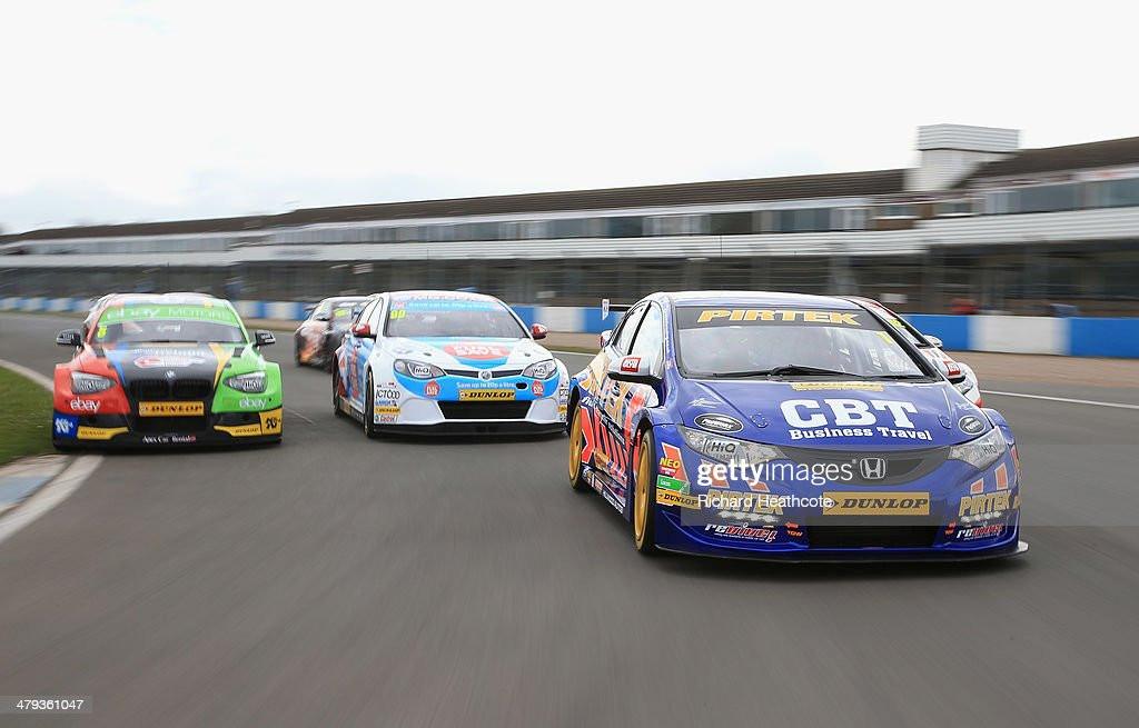 Current champion Andrew Jordan (R) in his Pirtek Racing Honda Civic leads the pack around on a display lap during the 2014 Dunlop MSA British Touring Car Championship media day at Donington Park on March 18, 2014 in Castle Donington, England.