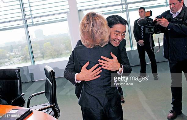 Current German Health Minister and leading member of the German Free Democrats political party Philipp Roesler welcomes German Minister of Work and...