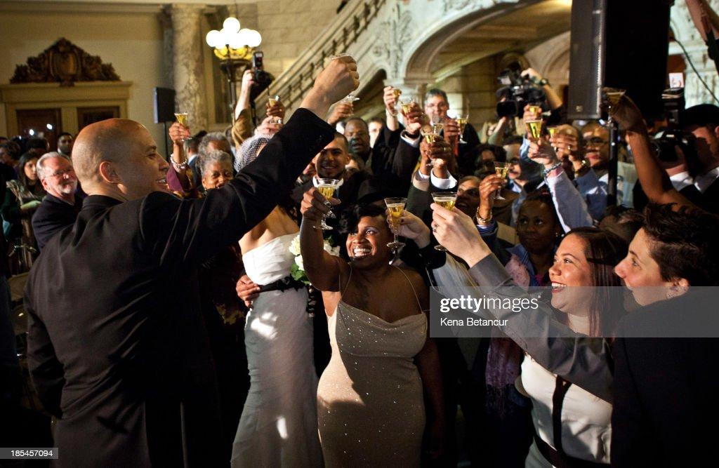 Current Mayor of Newark and U.S. Senator-elect Cory Booker makes a toast after officiating a number of wedding ceremonies at City Hall in the early morning hours of October 21, 2013 in Newark, New Jersey. Same-sex couples were allowed to legally wed at 12:01 am on Monday across New Jersey, making the state the 14th to allow same-sex marriages. Following Friday's ruling by the New Jersey Supreme Court, Mayor Cory A. Booker will marry seven gay, lesbian, and straight couples at City Hall in Newark on Monday morning.