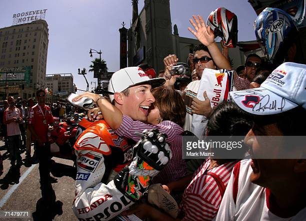 Current MotoGP championship leader Nicky Hayden greets fans during the MotoGP Goes Hollywood press event on Hollywood Blvd on July 18 2006 in...
