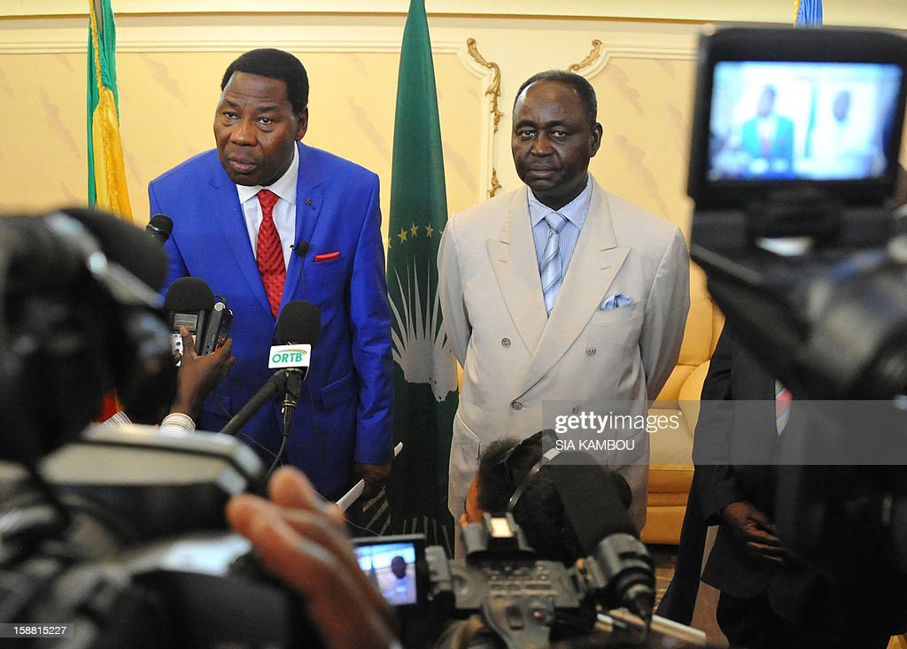 Current president of the African Union and President of Benin Yayi Boni (L) speaks during a joint press conference with the President of the Central African Republic Francois Bozize (2nd R) at the airport in Bangui, on December 30, 2012. Rebels in the Central African Republic who have advanced towards the capital Bangui warned they could enter the city even as the head of the African Union prepared to launch peace negotiations. Central African President Francois Bozize also stated today he was open to a national unity government after talks with rebel leaders and that he would not run for president in 2016. AFP PHOTO/ SIA KAMBOU