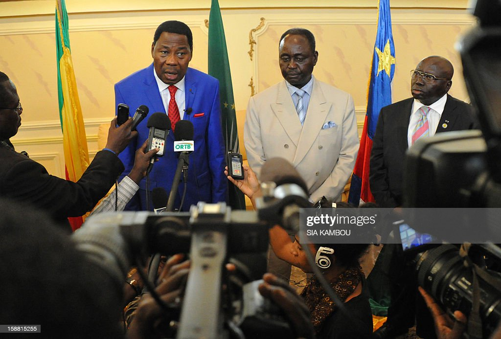 Current president of the African Union and President of Benin Yayi Boni (L) speaks during a joint press conference with the President of the Central African Republic Francois Bozize (2nd R) at the airport in Bangui, on December 30, 2012. Rebels in the Central African Republic who have advanced towards the capital Bangui warned they could enter the city even as the head of the African Union prepared to launch peace negotiations. Central African President Francois Bozize also stated today he was open to a national unity government after talks with rebel leaders and that he would not run for president in 2016.