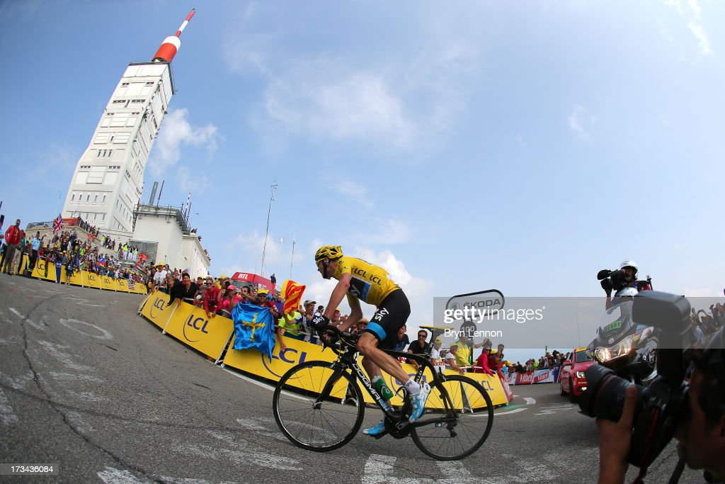 Current race leader and wearer of the Maillot Jaune, <a gi-track='captionPersonalityLinkClicked' href=/galleries/search?phrase=Chris+Froome&family=editorial&specificpeople=5428054 ng-click='$event.stopPropagation()'>Chris Froome</a> of Great Britain and SKY Procycling attacks to win the stage during stage fifteen of the 2013 Tour de France, a 242.5KM road stage from Givors to Mont Ventoux, on July 14, 2013 on Mont Ventoux, France.
