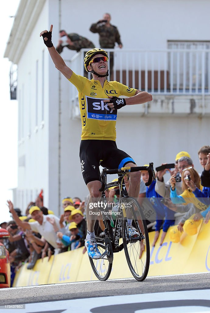 Current race leader and wearer of the Maillot Jaune, <a gi-track='captionPersonalityLinkClicked' href=/galleries/search?phrase=Chris+Froome&family=editorial&specificpeople=5428054 ng-click='$event.stopPropagation()'>Chris Froome</a> of Great Britain and SKY Procycling celebrates winning stage fifteen of the 2013 Tour de France, a 242.5KM road stage from Givors to Mont Ventoux, on July 14, 2013 on Mont Ventoux, France.
