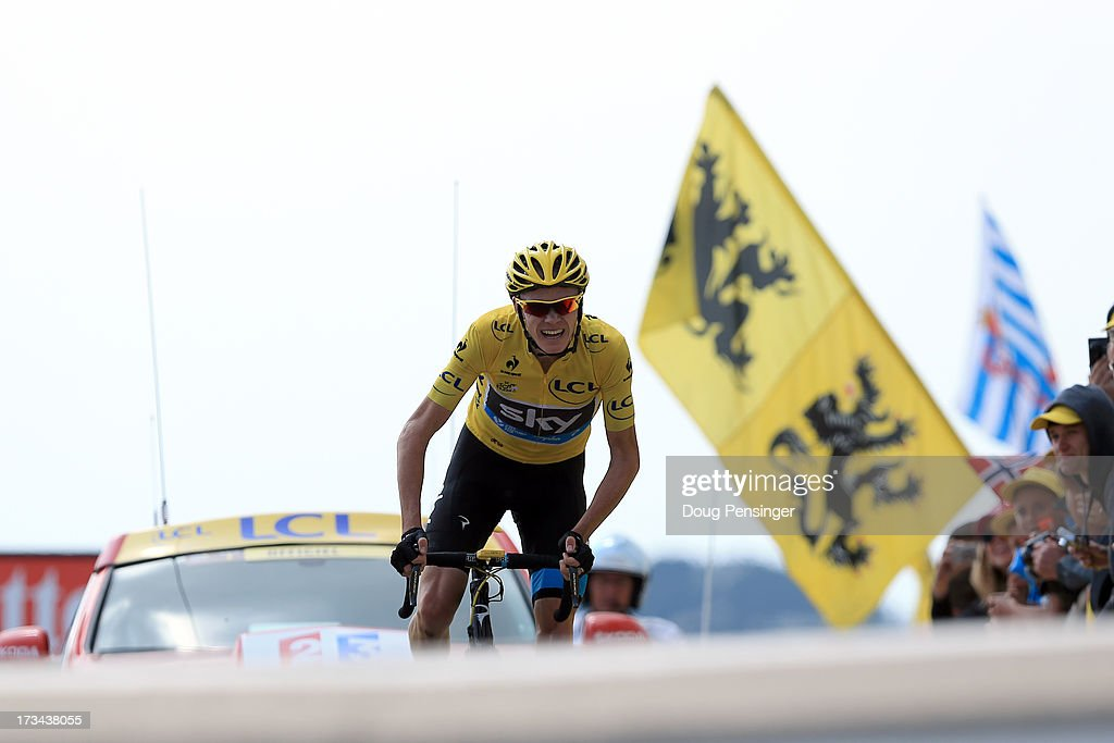 Current race leader and wearer of the Maillot Jaune, Chris Froome of Great Britain and SKY Procycling celebrates winning stage fifteen of the 2013 Tour de France, a 242.5KM road stage from Givors to Mont Ventoux, on July 14, 2013 on Mont Ventoux, France.