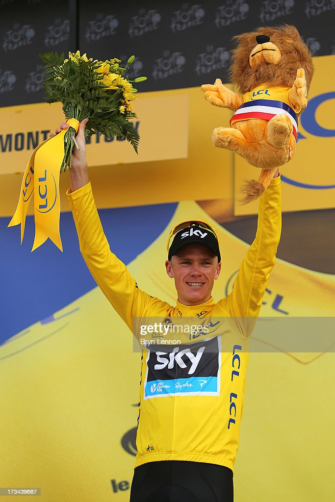 Current race leader and wearer of the Maillot Jaune, Chris Froome of Great Britain and SKY Procycling celebrates on the podium after winning stage fifteen of the 2013 Tour de France, a 242.5KM road stage from Givors to Mont Ventoux, on July 14, 2013 on Mont Ventoux, France.