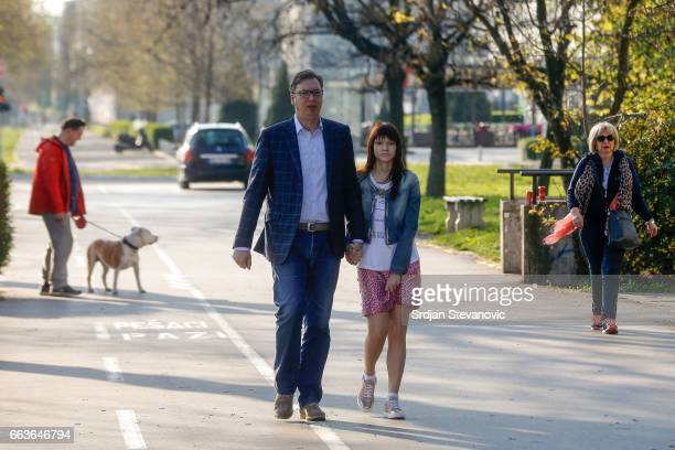 Current Serbian Prime Minister and presidential candidate Aleksandar Vucic leaves a polling station with his daughter Milica after voting for the...