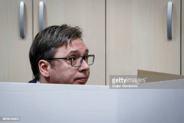 Current Serbian Prime Minister and presidential candidate Aleksandar Vucic prepares to cast his ballot at a polling station on April 2 2017 in...