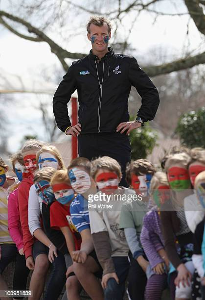 Current Single Sculls World Champion Mahe Drysdale of New Zealand poses with school children from Cambridge Primary school with their faces painted...