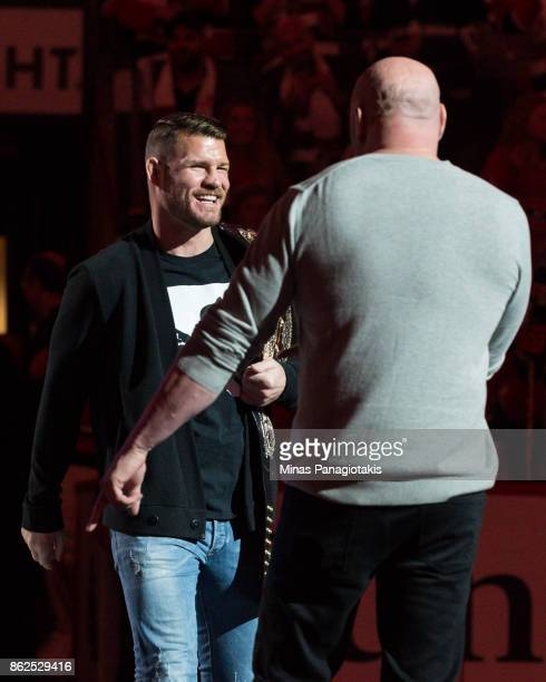 Current UFC middleweight champion Michael Bisping meets Dana White on centre ice prior to the NHL game between the Montreal Canadiens and the Toronto...