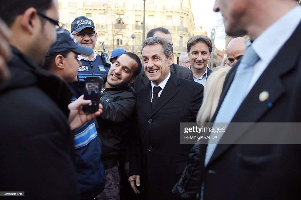 Current UMP President and former French President <a gi-track='captionPersonalityLinkClicked' href=/galleries/search?phrase=Nicolas+Sarkozy&family=editorial&specificpeople=211375 ng-click='$event.stopPropagation()'>Nicolas Sarkozy</a> (C) reacts within a commemoration ceremony for the victims of French jihadist gunman Mohamed Merah, in Toulouse on March 19, 2015. Merah shot dead three soldiers in southern France in 2012 before killing three students and a teacher at a Jewish school more than a week later. AFP PHOTO / REMY GABALDA