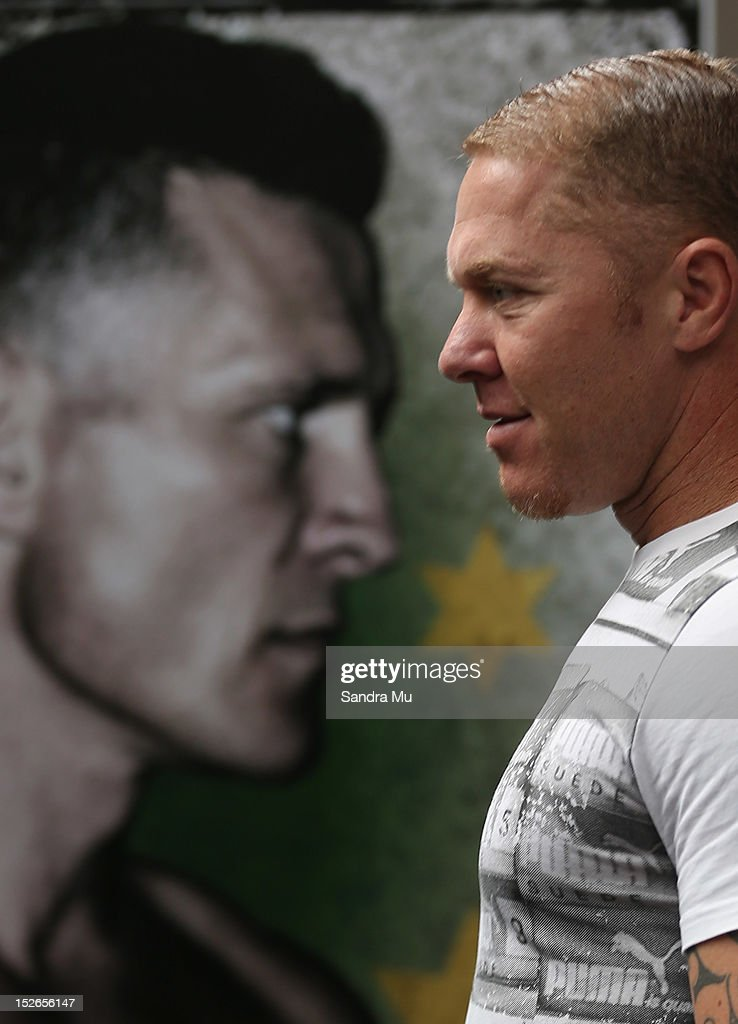 Current WBO Asia Pacific Oriental Heavyweight Champion Shane Cameron stands face on to a poster of Danny Green as he talks to media at a press...