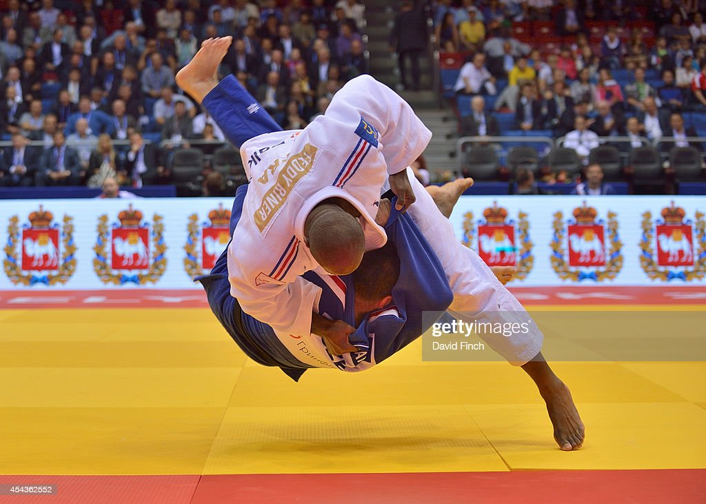 Current World and Olympic champion, <a gi-track='captionPersonalityLinkClicked' href=/galleries/search?phrase=Teddy+Riner&family=editorial&specificpeople=4114927 ng-click='$event.stopPropagation()'>Teddy Riner</a> of France (white) throws Michal Horak of the Czech Republic for ippon (10 points) in his second o100kg contest during the Chelyabinsk Judo World Championships at the Sport Arena 'Traktor' on August 30, 2014 in Chelyabinsk, Russia.