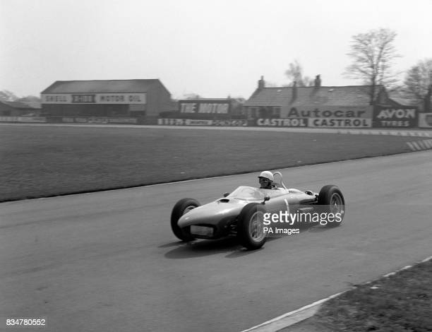 Current World Champion American Phil Hill Ferrari during practice for the Aintree 200 International Motor Race meeting