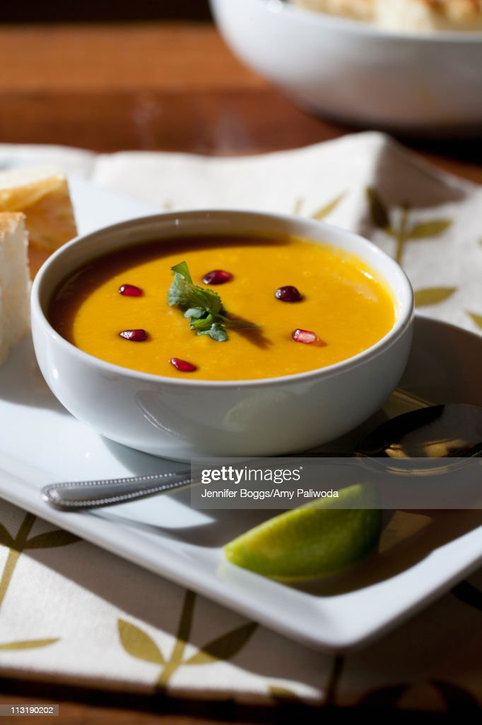 Curry soup in bowl with garnish : Stock Photo