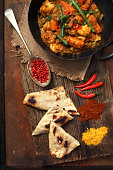 Curry with naan bread and indian spice