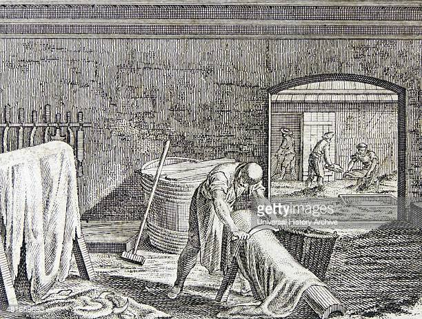 Currying leather man beaming to remove the hair from an animal skin that has been soaking in the tan yard in the background Engraving after Daniel...