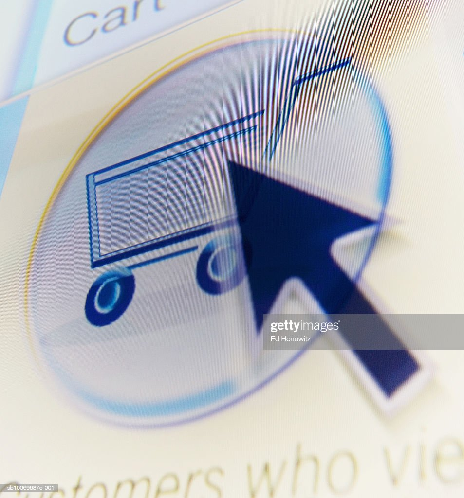 Cursor on shopping cart icon button, studio shot : Stock Photo
