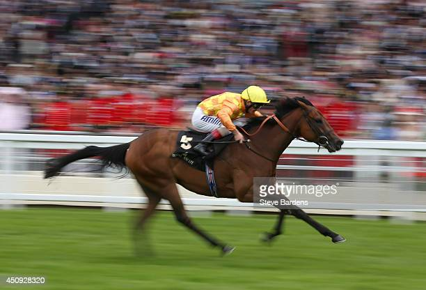 Cursory Glance ridden by Andrea Atzeni breaks away to win the Albany stakes on day four of Royal Ascot at Ascot Racecourse on June 20 2014 in Ascot...