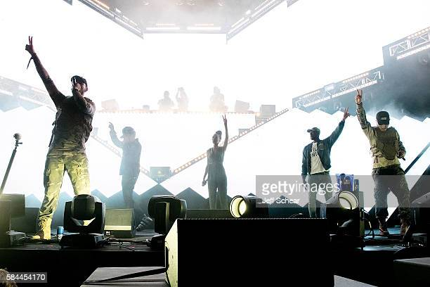 Curt Cameruci of Flosstradamus Chance the Rapper Michelle Williams Dwyane Wade and Josh Young of Flosstradamus peform at the Bud Light Stage Moment...