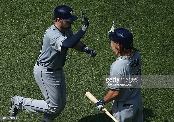 Curt Casali of the Tampa Bay Rays is congratulated by John Jaso after hitting a solo home run in the eighth inning during MLB game action against the...