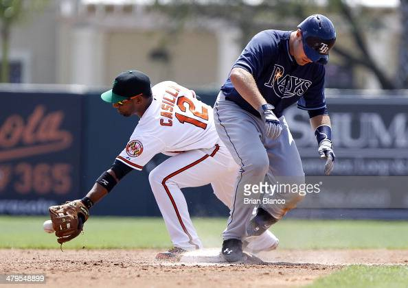 Curt Casali of the Tampa Bay Rays slides safely into second base in front of Alexi Casilla of the Baltimore Orioles after hitting a double during the...